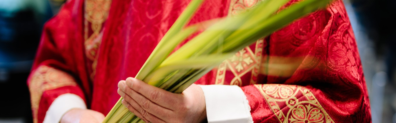 A minister with palm leaves
